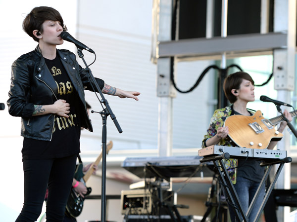 Tegan Quin (L) and Sara Quin of Tegan and Sara perform at Y100´s Pre-Show at the Jingle Ball Village on the plaza at the BB&T Center on December 20, 2013 in Miami, Florida.  (Photo by Larry Marano/Getty Images for Clear Channel)