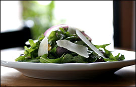 Arugula salad with blood orange vinaigrette and Quizzo nights are the new scene on a corner where the old scene was a lively and notorious drug market.                                      (Eric Mencher/Inquirer)