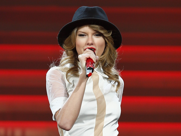 Seven-time Grammy winner Taylor Swift took the European leg of her blockbuster The RED Tour show to Berlin´s, O2 World playing to a capacity crowd of more than 10,700 fans on February 7, 2014 in Berlin, Germany.  (Photo by Andreas Rentz/Getty Images for TAS)