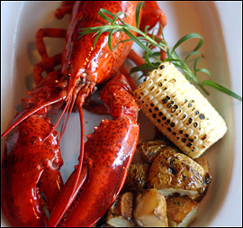 The $20 lobster dinner, with potatoes and grilled corn, is one of Cork´s successful entrees.                                      (Sarah J. Glover/Inquirer)