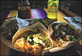 Three tacos (from left): Barbacoa goat, cheese, and spicy pork al pastor with pineapple.