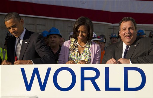In this June 14 photo, President Barack Obama, first lady Michelle Obama and New Jersey Gov. Chris Christie sign a white steel beam as they visit the Port Authority of New York and New Jersey&acute;s World Trade Center site for a briefing on construction progress, in New York. Obama gave the Democratic convention&acute;s keynote address in 2004. Christie will deliver the Republicans&acute; keynote address in two weeks. (AP Photo/Carolyn Kaster, File)<br />
