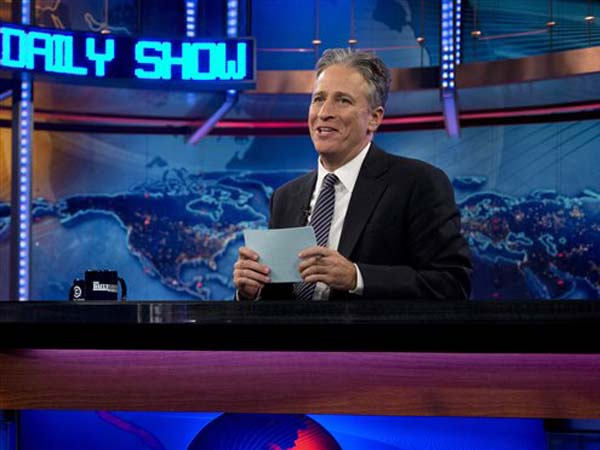 "This Oct. 18, 2012 file photo shows host Jon Stewart during a taping of ""The Daily Show with John Stewart"", in New York. Stewart took a break from ""The Daily Show"" starting in June to direct and produce his first feature film. Correspondent-writer John Oliver has hosted the fake news show for the eight weeks of original episodes scheduled during Stewart´s hiatus. The British-born Oliver has been a ""Daily Show"" regular since 2006. (AP Photo/Carolyn Kaster, file)"
