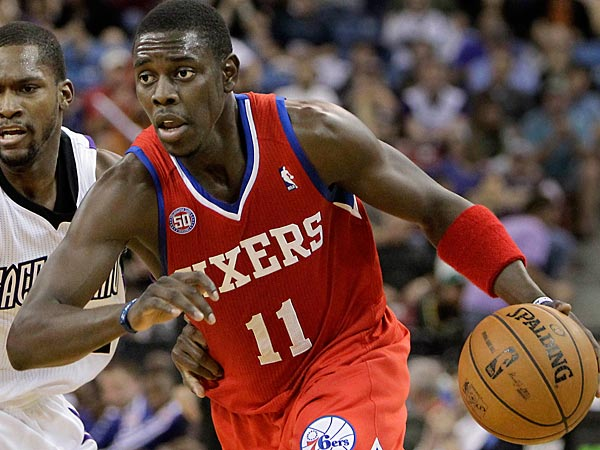 In this photo taken March 24, 2013 Philadelphia 76ers guard Jrue Holiday, right, drives past Sacramento Kings guard Toney Douglas during the first quarter of an NBA basketball game in Sacramento, Calif. The 76ers won 117-103.(AP Photo/Rich Pedroncelli)