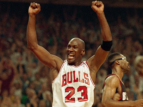 The Chicago Bulls´ Michael Jordan celebrates the Bulls´ win over the Portland Trail Blazers in the NBA Finals in Chicago, June 14, 1992. The Bulls beat the Trail Blazers 97-93 to repeat as champions. (AP Photo/John Swart)