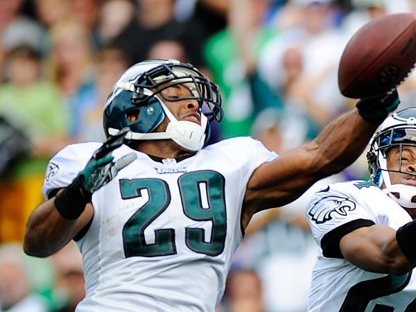 Philadelphia Eagles free safety Nate Allen, left, and cornerback Nnamdi Asomugha, center, break up a pass intended for Baltimore Ravens wide receiver Jacoby Jones in the end zone during the second half of an NFL football game, Sunday, Sept. 16, 2012, in Philadelphia. (AP Photo/Michael Perez)