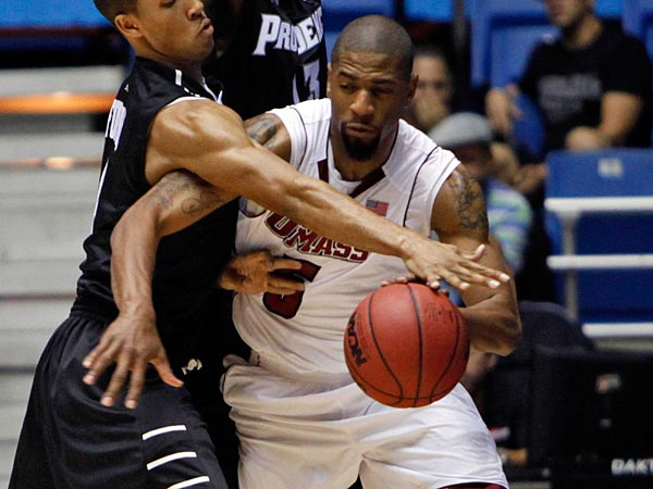 UMass' Jesse Morgan, right, battles for the ball against Providence's players Sidiki Johnson, left, and Brice Kofane during the first half of a NCAA college basketball game in Bayamon, Puerto Rico, Thursday, Nov. 15, 2012. (AP Photo/Ricardo Arduengo)