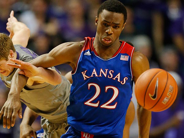 Kansas guard Andrew Wiggins (22) and Kansas State guard Will Spradling, left, chase the ball during the second half of an NCAA college basketball game in Manhattan, Kan., Monday, Feb. 10, 2014. Kansas State defeated Kansas 85-82 in overtime. (AP Photo/Orlin Wagner)
