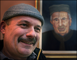 Radovan Jacovic painted the portrait of grandfather Lazar that hangs above the restaurant kitchen.                                      (Ron Cortes/Inquirer)