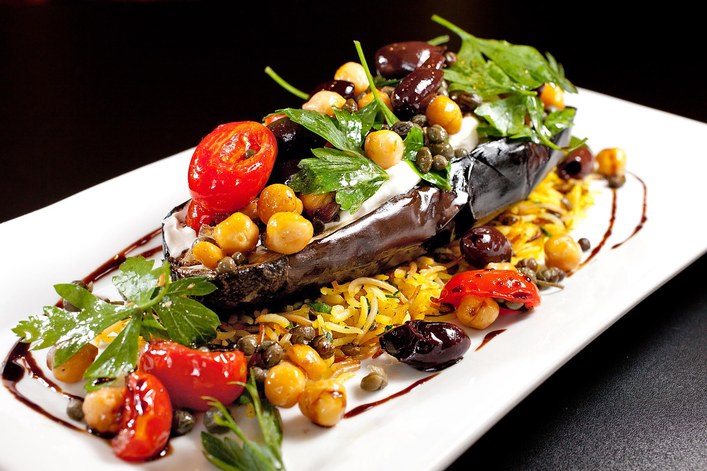Char-roasted eggplant with olives, grape tomatoes, capers and oregano at Park Plates.