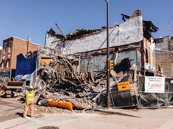 The former Shirt Corner collapses during demolition work in Philadelphia on March 13, 2014. (Dan King / For Philly.com)