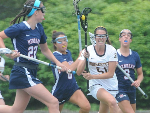 JMOOR01P  MARIE MCCOOL, (51) runs the ball downfieled as Mendham&acute;s<br />Grace Gaffney (22), Becky Gonsler (6), and Carlye Maita pursue.<br />Moorestown HS girls lacrosse team beat Mendham 6-4 for the NJ State<br />GROUP 3 Championship at Monmouth U. Photo / Curt Hudson