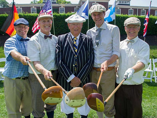 Sporting their knickers, ties and floppy caps, and holding their old-fashioned hickory shaft drivers, are competitors (from left) Craig Stroud, 47, Thomasville, NC; Mark Hollinsworth, 57, Pinehurst, NC; Sir Lionel Freedman, 80, Musselburgh, Scotland, who is the honorary starter for the World Hickory Match Play Championship at the Philadelphia Cricket Club; Paolo Quirici, 46, Switzerland, who is the 2013 World Hickory Open Champion; and Eric Hjortness (cq), 52, Menasha, WI.  Photo taken June 17, 2014. (Clem Murray/Staff Photographer)