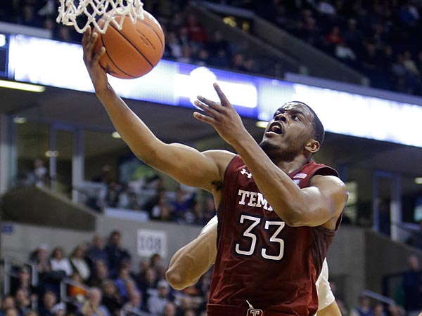 Temple guard Scootie Randall (33) drives against Xavier in the second half of an NCAA college basketball game, Thursday, Jan. 10, 2013, in Cincinnati. Randall scored 13 points in the game won by Xavier 57-52. (AP Photo/Al Behrman)