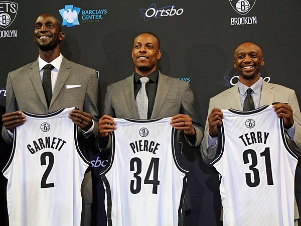 The Brooklyn Nets, from left, Kevin Garnett, Paul Pierce and Jason Terry, pose for photographers with their new jerseys during an NBA basketball news conference, Thursday, July 18, 2013 at Barlcays Center in New York. The Nets introduced the trio they acquired in a blockbuster trade with the Boston Celtics. (AP Photo/Mary Altaffer)