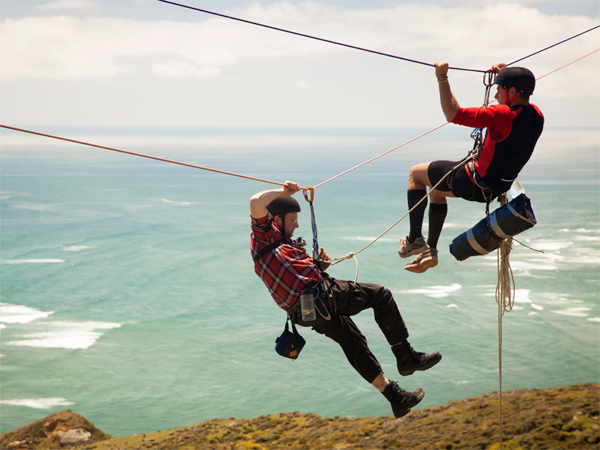 "Eric Martin of Harleysville (left) gets help from teammate Michael to complete a Tyrolean traverse on TNT´s ""72 Hours"" on June 13, 2013. Their team was first to the $100,000 in a hidden briefcase."