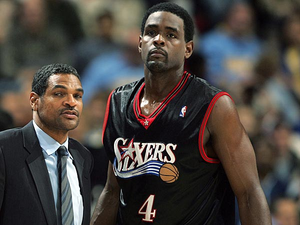 Philadelphia 76ers head coach Maurice Cheeks, left, confers with forward Chris Webber in the fourth quarter of the 76ers´ 108-106 victory over the Denver Nuggets in an NBA basketball contest in Denver on Tuesday, Dec. 27, 2005. Cheeks will lead his new team, the Sixers, into Portland for the first time on Wednesday since Cheeks was dismissed as the leader of the Portland Trail Blazers at the conclusion of last season. (AP Photo/David Zalubowski)