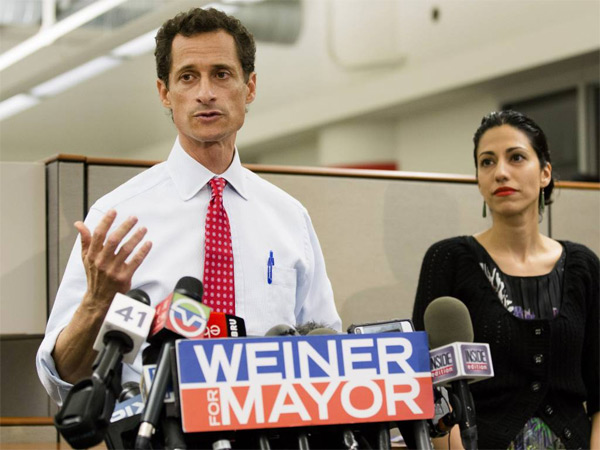 New York mayoral candidate Anthony Weiner speaks during a news conference alongside his wife Huma Abedin at the Gay Men´s Health Crisis headquarters, Tuesday, July 23, 2013, in New York. (AP Photo/John Minchillo)
