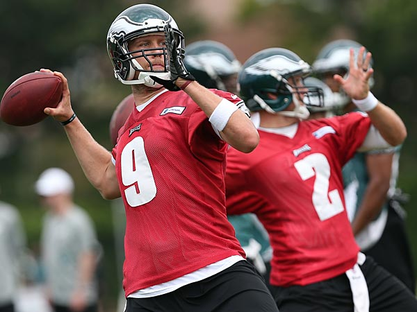 Eagles&acute; quarterback Nick Foles, left, throws a pass during the<br />Philadelphia Eagles Training Camp at the NovaCare Complex in<br />Philadelphia on July 27, 2014. DAVID MAIALETT / Staff Photographer