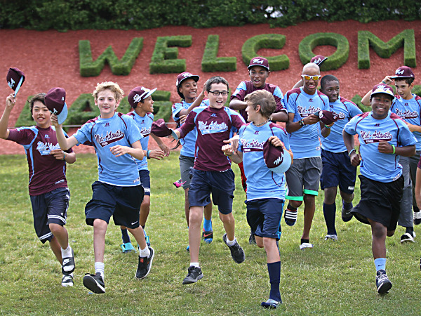 "Shooting a Little League World Series promo for ESPN, Taney is told to run toward the camera with their caps off and ""look very happy,"" Tuesday, August 19, 2014. They complied. (Michael Bryant/Staff Photographer)"