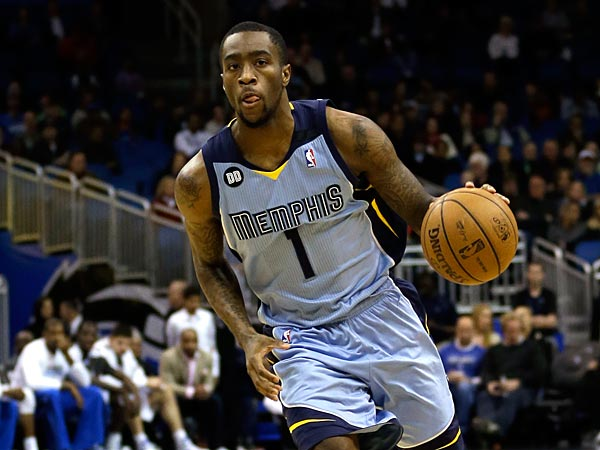 Memphis Grizzlies´ Tony Wroten (1) moves the ball against the Orlando Magic during the first half of an NBA basketball game, Sunday, March 3, 2013, in Orlando, Fla. (AP Photo/John Raoux)