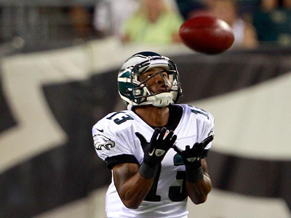 Eagles&acute; Damaris Johnson watches the football on a punt  against the<br />New York Jets in a preseason game on Thursday, August 30, 2012.  (<br />Yong Kim / Staff Photographer )