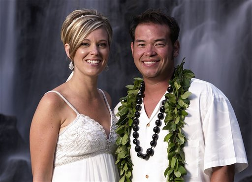 FILE - This image released by TLC, shows Jon Gosselin, right, and his wife Kate Gosselin, from the TLC series &quot;Jon &amp; Kate Plus 8,&quot; in Hawaii. (AP Photo/TLC, Mark Arbeit) NO SALES<br />
