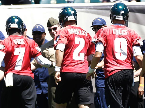 Philadelphia Eagles quarterbacks Michael Vick, left, Matt Barkley,<br />Nick Foles, G.J. Kinne, and Dennis Dixon meet with members of the<br />military at the NFL football team&acute;s training camp in Philadelphia,<br />Monday, Aug. 5, 2013. (AP Photo/Matt Rourke)