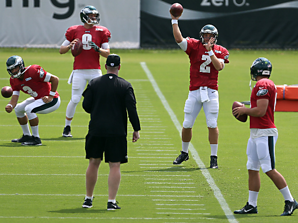 Quarterbacks Mark Sanchez, left, Nick Foles, second from left, Matt<br />Barkley, second from right, and G. J. Kinne, right, warm up at<br />Philadelphia Eagles Training Camp at NovaCare Complex in Philadelphia on August 4, 2014. (David Maialetti/Staff Photographer)