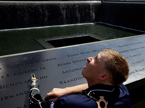 File photo: US Marine Cpl. Mark Litynski of New Hope, Minn., looks up at One World Trade while visiting the 9/11 Memorial at ground zero in New York, Wednesday, July 4, 2012. (AP Photo/Seth Wenig)