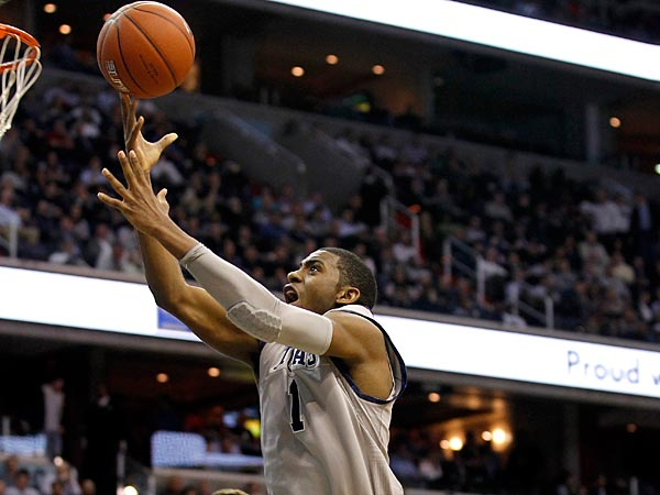 Georgetown´s Hollis Thompson drives toward the basket in front of Connecticut´s Tyler Olander (10) and Ryan Boatright (11) during the second half of an NCAA college basketball game, Wednesday, Feb. 1, 2012, in Washington. Georgetown won 58-44. (AP Photo/Haraz Ghanbari)