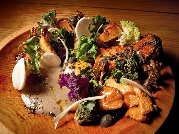 A medley of exotic mushrooms is served with sunchokes, smoky eggplant, young kale, and a farm-fresh egg at High Street.