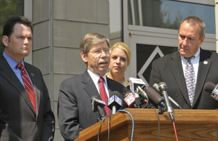 Attorneys General Bill McCollum, center, of Florida; Troy King, left,<br />of Alabama; and Mark Shurtleff, right, of Utah hold a press conference<br />outside the U.S. Federal Courthouse in Pensacola, Fla. Tuesday, Sept.<br />14, 2010, after a hearing to have all or portions of the Affordable<br />Care Act dismissed as unconstitutional.(AP Photo/Pensacola News<br />Journal, Tony Giberson)