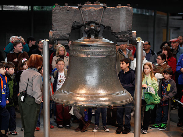 Visitors to Independence National Historical Park view the Liberty Bell Friday, April 8, 2011 (AP Photo/Matt Rourke)