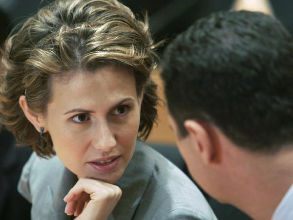 Syrian President Bashar al-Assad, right, listens to his wife Asma Assad during their visit to the campus of Infosys Technologies Ltd., an Indian software services company, in Bangalore, India, Friday, June 20, 2008.  Al-Assad is on five day official visit to India. (AP Photo/Aijaz Rahi)