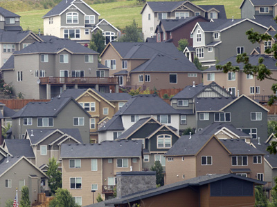 A hillside covered with homes in Happy Valley, Ore. Nationwide, many homeowners are broke and feeling bitter. (AP Photo/Rick Bowmer)