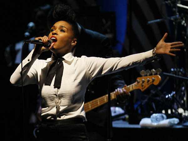 R&B singer Janelle Monae performs for the audience during a campaign event for President Barack Obama, Wednesday, Jan. 11, 2012, in Chicago. (AP Photo/Charles Rex Arbogast)
