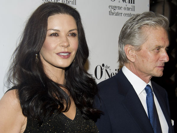 Honoree Michael Douglas and his wife Catherine Zeta-Jones attend the Eugene O´Neill Theater Center´s 12th Annual Monte Cristo Awards in New York, Monday, April 16, 2012. (AP Photo/Charles Sykes)