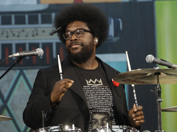 "The Roots´ Ahmir ""Questlove"" Thompson performs during an Independence Day celebration, Wednesday, July 4, 2012, in Philadelphia. (AP Photo/Matt Rourke)"