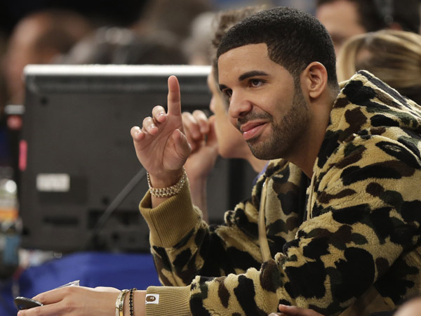 Rapper Drake during the second half of the NBA basketball game between the Indiana Pacers and the New York Knicks Sunday, April 14, 2013 in New York. (AP Photo/Seth Wenig)