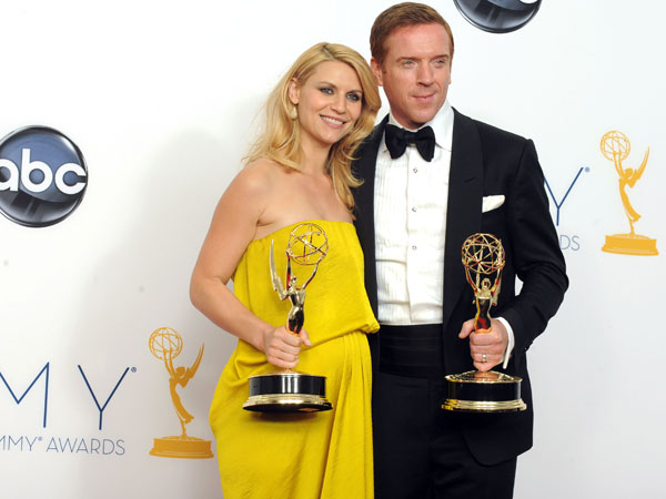 "This Sept. 23, 2012 photo shows actress ClaireDanes, winner of the Emmy for Outstanding Lead Actress In A Drama Series for ""Homeland"" and Actor Damian Lewis, winner Outstanding Lead Actor In A Drama Series for ""Homeland"" posing backstage at the 64th Primetime Emmy Awards at the Nokia Theatre in Los Angeles. The second season of the Emmy award-winning series premieres Sunday at 10p.m. EST on Showtime. (Photo by Jordan Strauss/Invision/AP)"