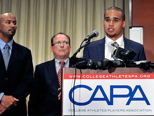 "Northwestern quarterback Kain Colter (right) speaks while College Athletes Players Association president Ramogi Huma left and United Steel Workers National Political Director Tim Waters second from left look on during a news conference in Chicago, Tuesday, Jan. 28, 2014. Calling the NCAA a ""dictatorship,"" a handful of Northwestern football players announced they are forming the first labor union for college athletes--one they hope will eventually represent players nationwide. (AP Photo/Paul Beaty)"