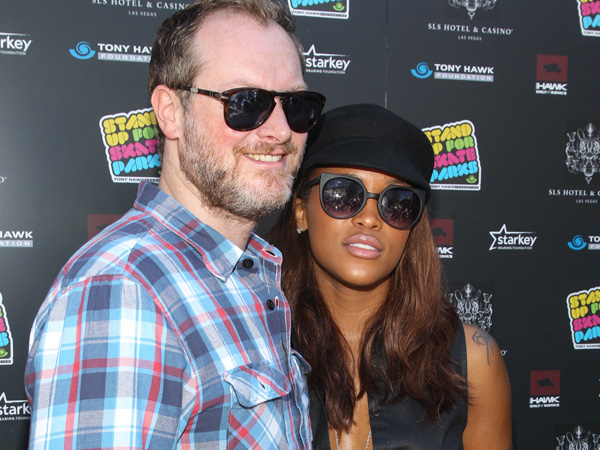Recording artist Eve and entrepreneur Maximillion Cooper attend the Tony Hawk´s 10th Annual Stand Up for Skateparks celebrity benefit on Saturday, Oct. 5, 2013 in Beverly Hills, Calif. (Photo by Paul A. Hebert/Invision/AP)