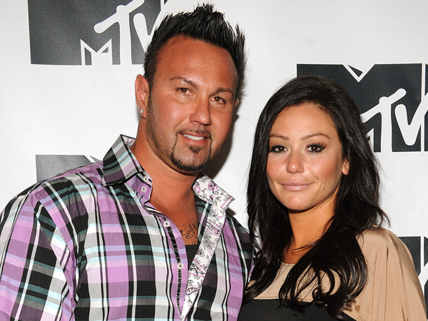 "Jenni ""JWoww"" Farley and Roger Mathews appear during MTV´s ""Restore the Shore"" telethon at the MTV Times Square Studios on Thursday, Nov. 15, 2012 in New York. (AP Photo/Scott Gries)"