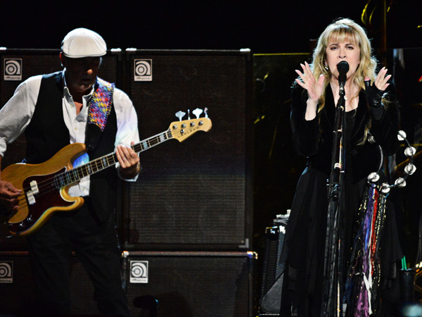 In this photo provided by the Las Vegas News Bureau, John McVie and Stevie Nicks perform as Fleetwood Mac takes the stage at the MGM Grand Garden Arena on Monday, Dec. 30, 2013, in Las Vegas. (AP Photo/Las Vegas News Bureau, Bryan Haraway)