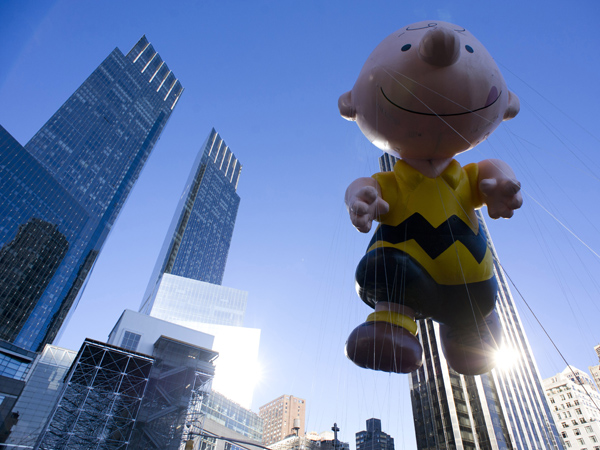 The Charlie Brown balloon floats in the Macy´s Thanksgiving Day Parade in New York in New York, Thursday, Nov. 22, 2012. (AP Photo/Charles Sykes)
