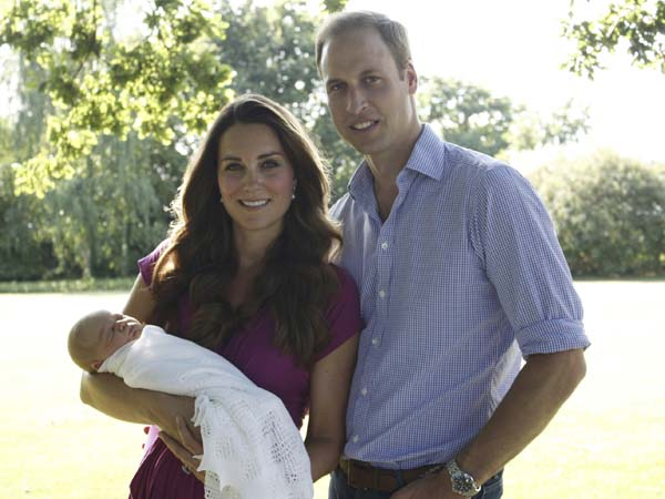 This image taken by Michael Middleton, the Duchess´s father, in early August 2013 and supplied by Kensington Palace, shows the Duke and Duchess of Cambridge with their son, Prince George, in the garden of the Middleton family home in Bucklebury, England. (AP Photo/Michael Middleton/TRH The Duke and Duchess of Cambridge ) EDITORIAL USE ONLY