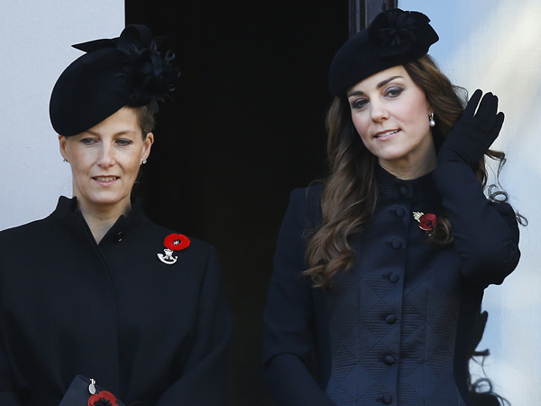 Britain´s Kate, the Duchess of Cambridge, right, and Sophie, the Countess of Wessex listen from a balcony during the service of remembrance at the Cenotaph in Whitehall, London, Sunday, Nov. 10, 2013. The annual remembrance service is to remember those who have lost their lives serving in the Armed Forces. (AP Photo/Kirsty Wigglesworth)