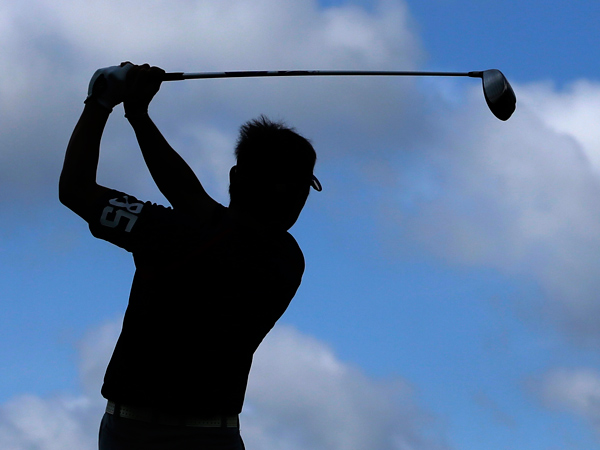 Dr. Robert Cabry gives advice on playing golf safely to avoid injury. (AP Photo/Darron Cummings)