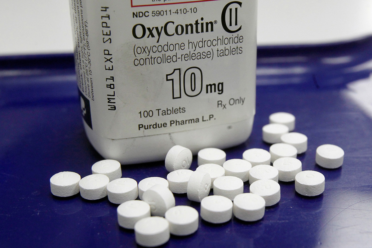 This Feb. 19, 2013, file photo, shows OxyContin pills arranged for a photo at a pharmacy in Montpelier, Vt.